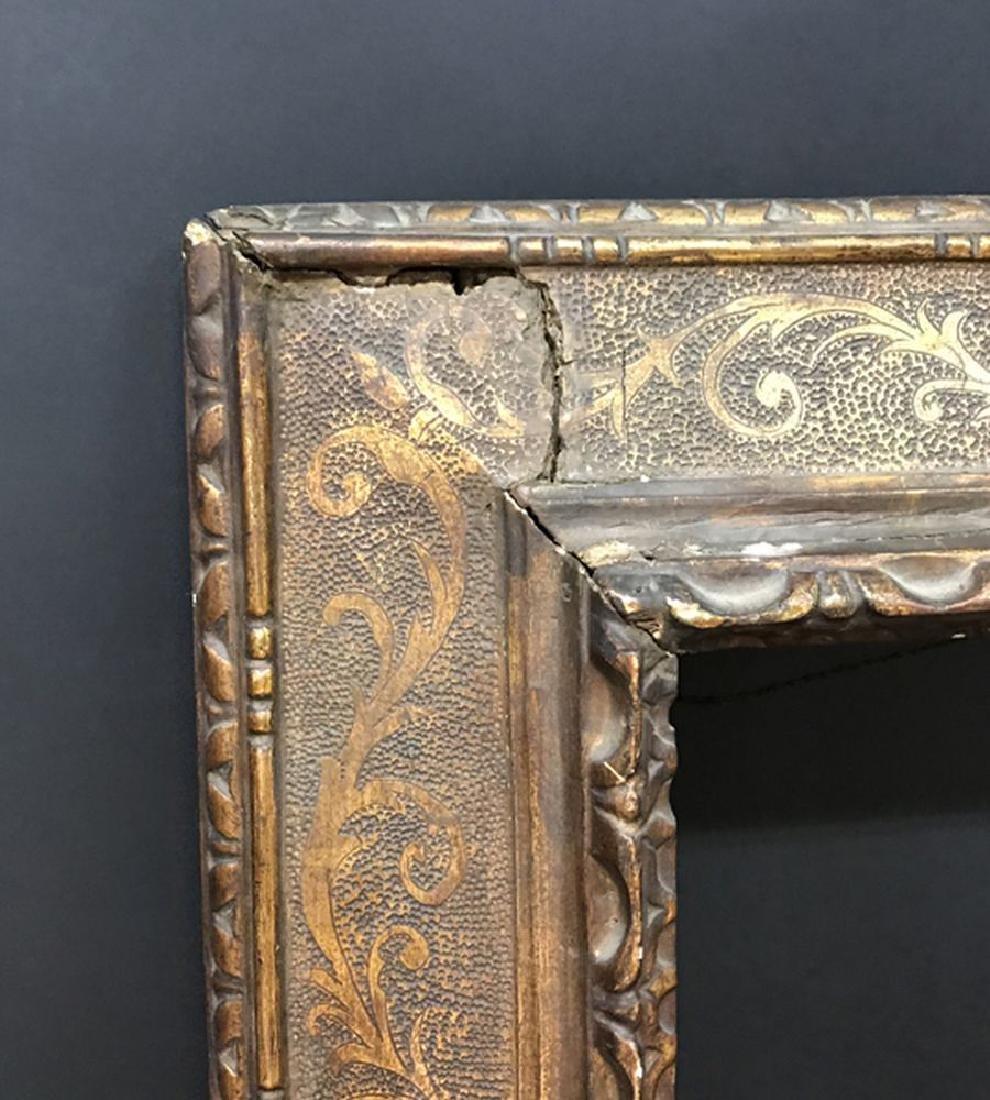 17th Century Italian School. A Gilded plate Frame,