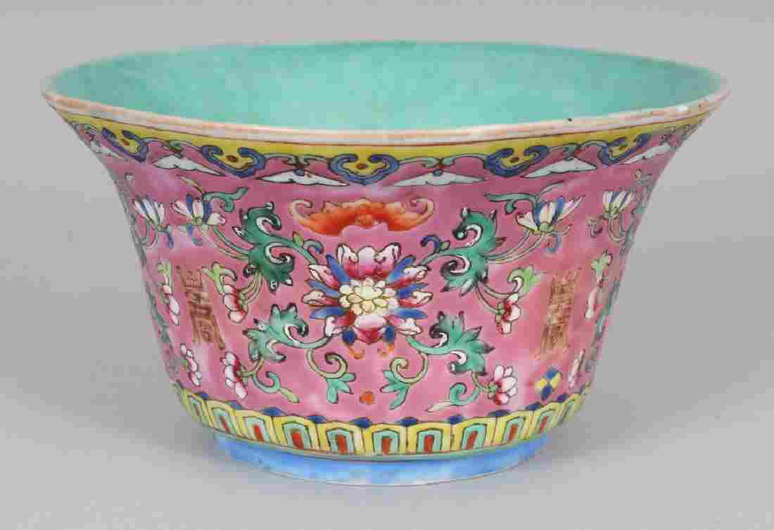 A CHINESE PINK GROUND FAMILLE ROSE PORCELAIN BOWL, the