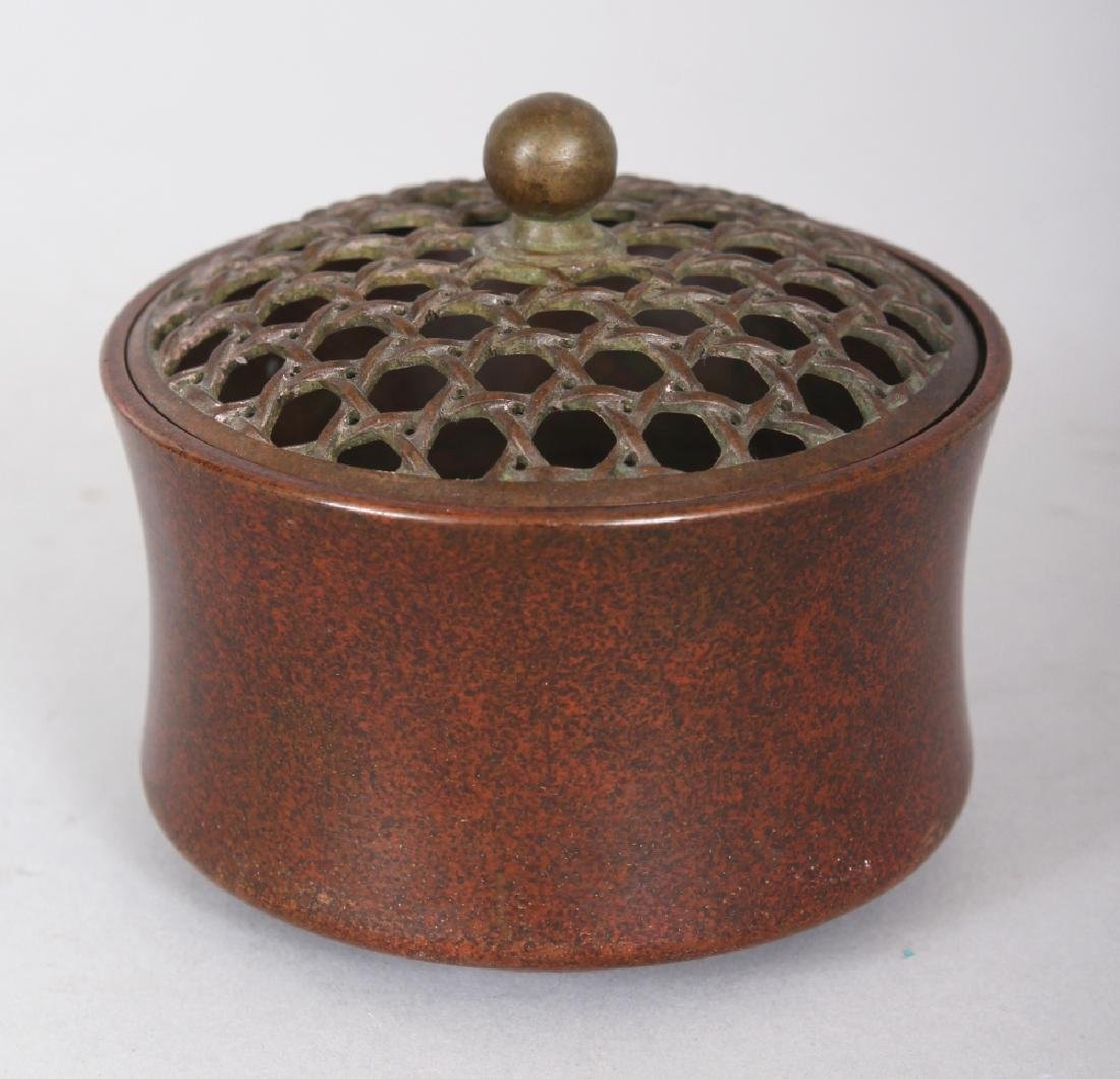 A SMALL CHINESE CIRCULAR BRONZE CENSER & PIERCED