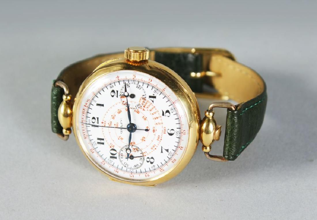 A GOOD 18K GOLD GELFO WRISTWATCH with leather strap.