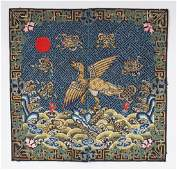 AN EARLY 20TH CENTURY CHINESE WOVEN FABRIC RANK BADGE