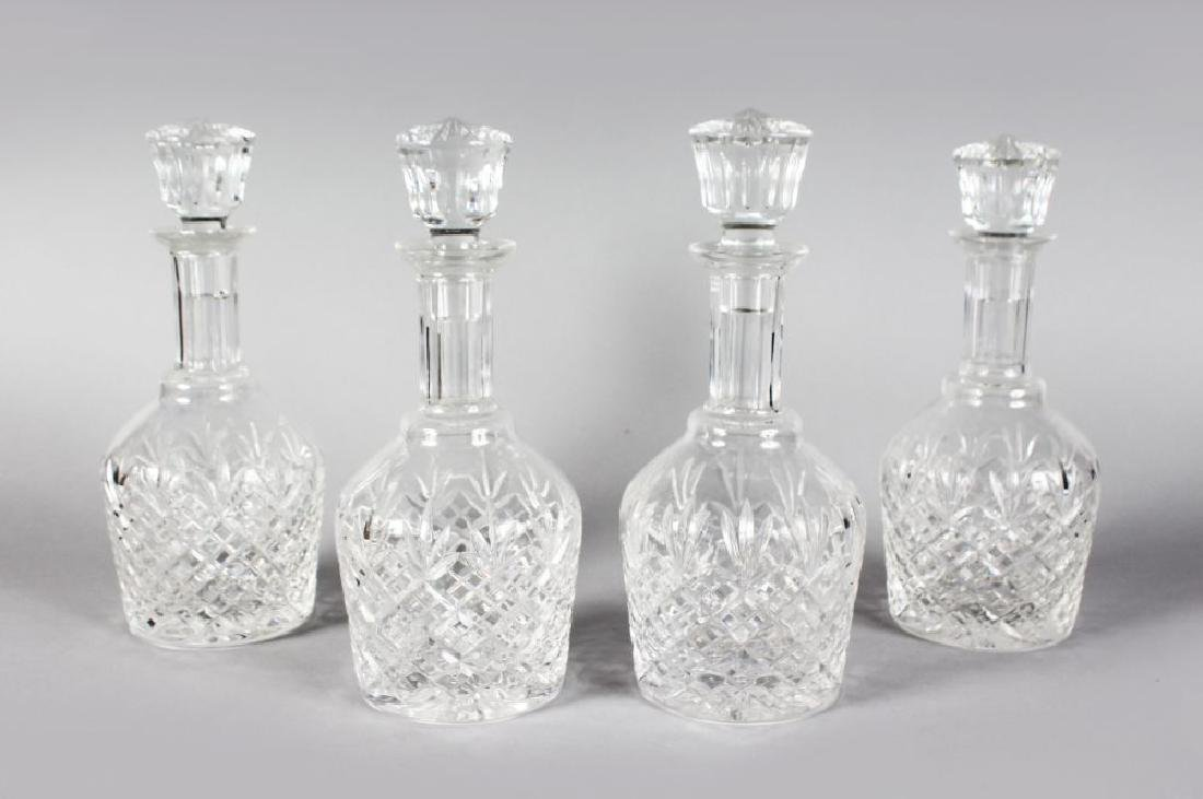 A GOOD SET OF FOUR STUART CUT MALLET DECANTERS AND