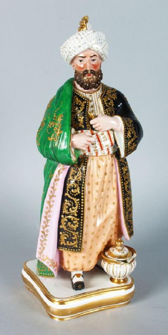 A PARIS PORCELAIN FIGURE OF A STANDING TURK wearing a
