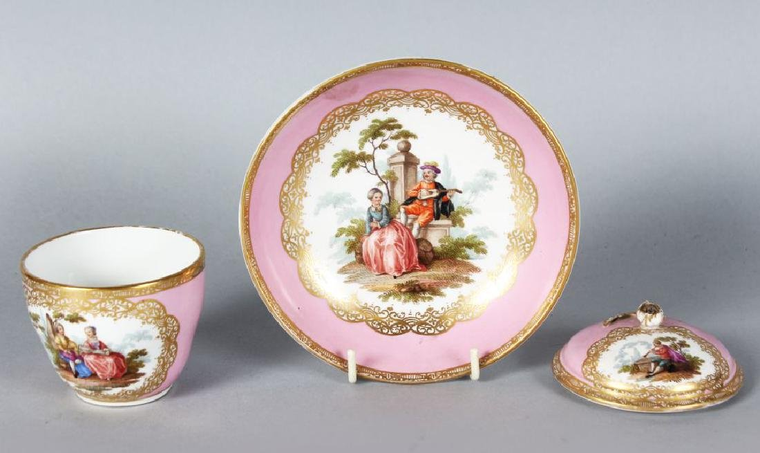 A MEISSEN CHOCOLATE CUP, COVER AND SAUCER painted with