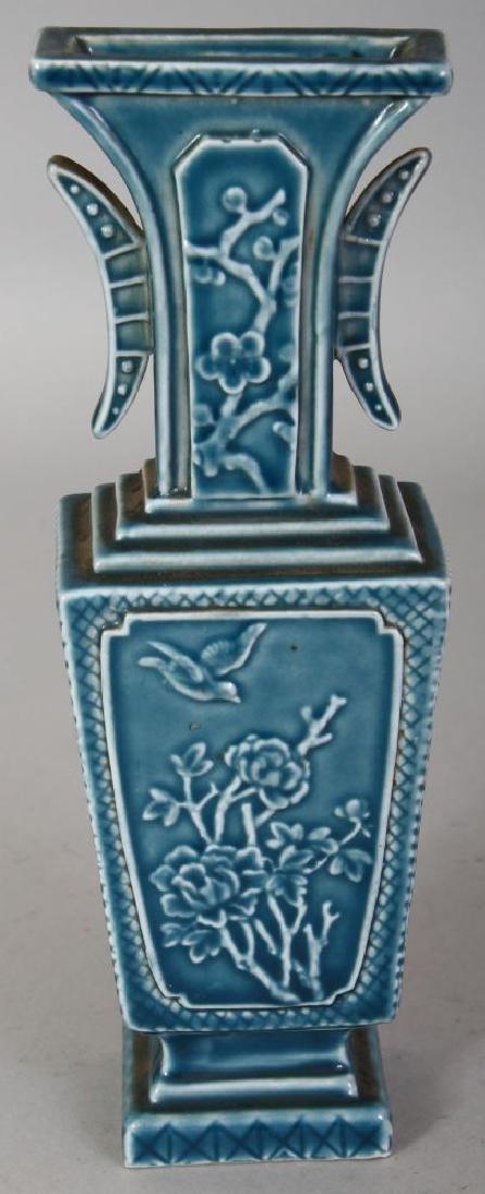 A CHINESE BLUE GLAZED MOULDED PORCELAIN VASE, the base