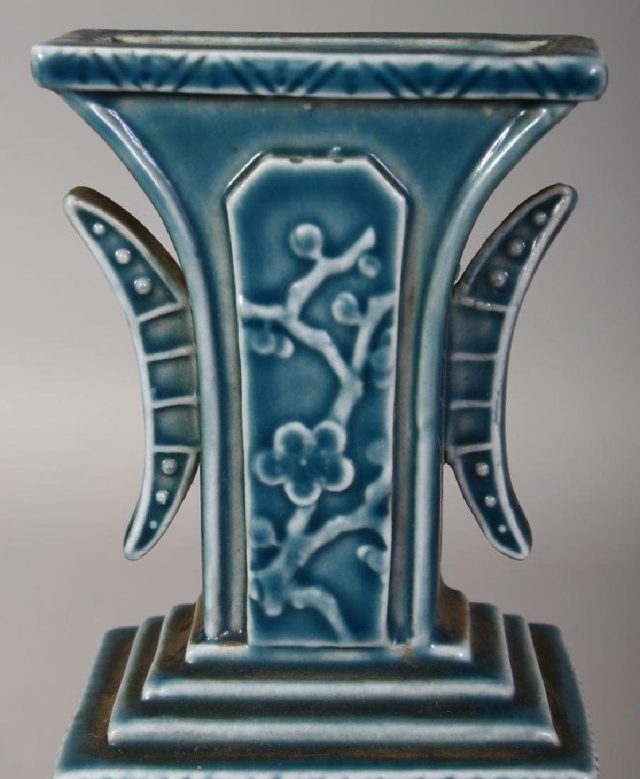 A CHINESE BLUE GLAZED MOULDED PORCELAIN VASE, the base - 6