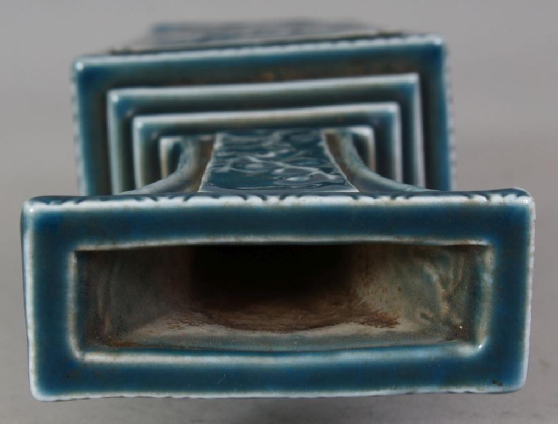 A CHINESE BLUE GLAZED MOULDED PORCELAIN VASE, the base - 8