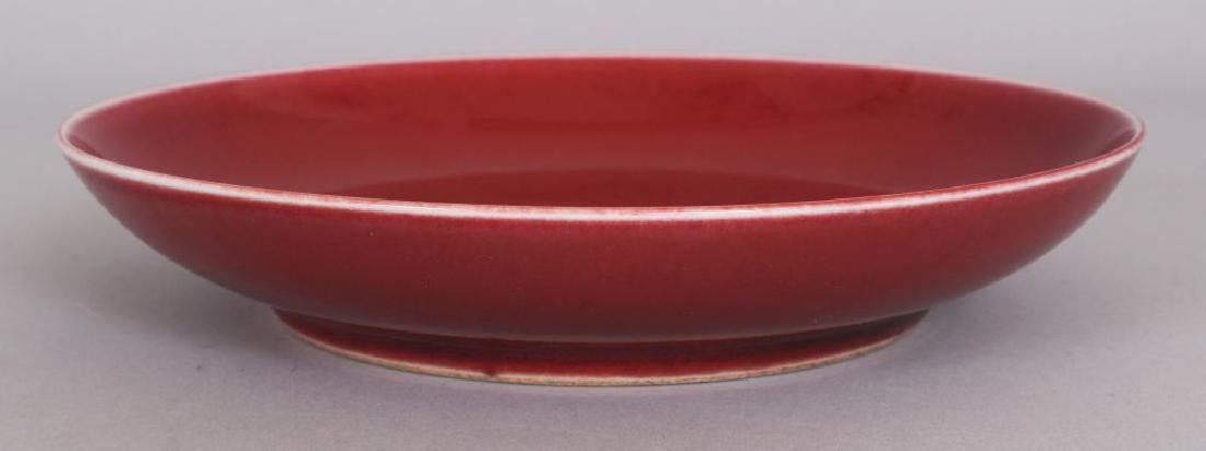 A CHINESE COPPER RED PORCELAIN SAUCER DISH, the base - 2