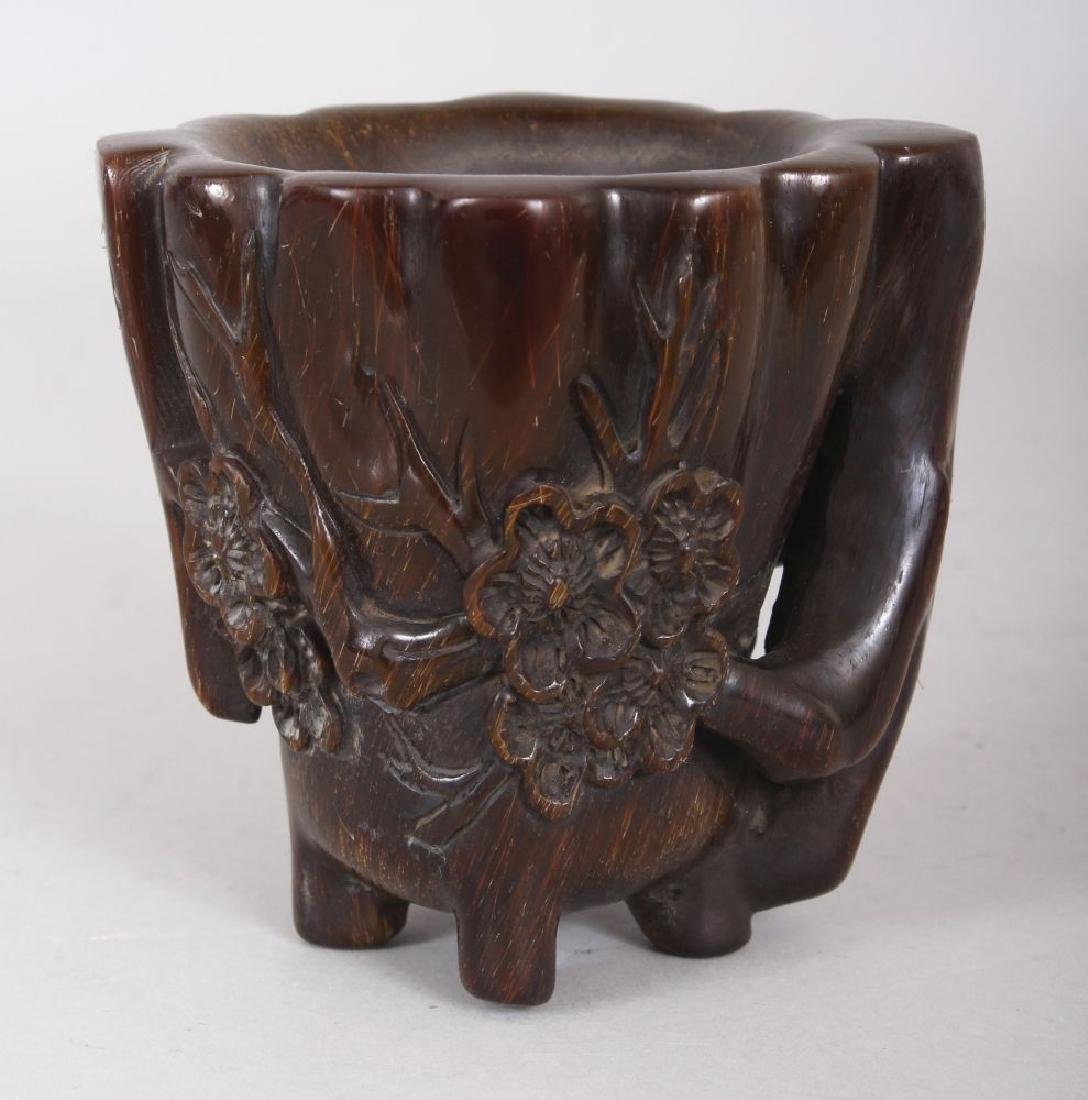 A CHINESE HORN-STYLE CUP, decorated in relief with