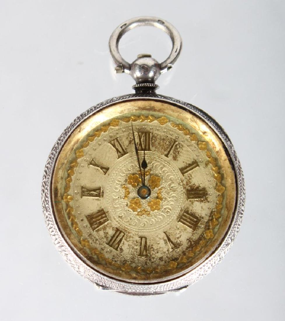 A VICTORIAN ENGRAVED SILVER FOB WATCH.