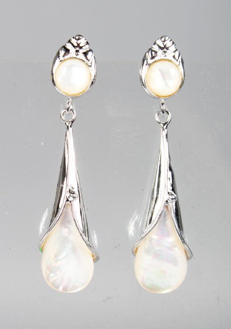 A PAIR OF SILVER AND MOTHER-OF-PEARL DROP EARRINGS.