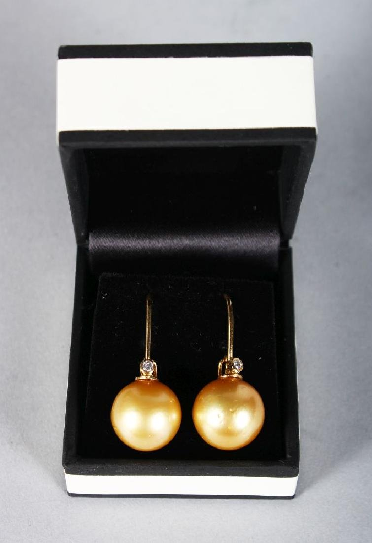 A PAIR OF YELLOW GOLD SOUTH SEA PEARL AND DIAMOND DROP