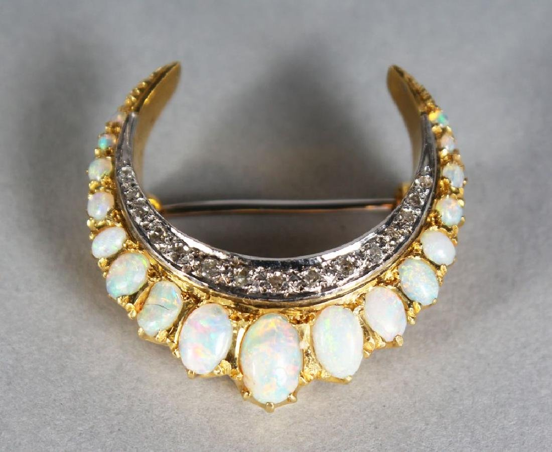 AN 18CT GOLD, DIAMOND AND OPAL CRESCENT BROOCH.