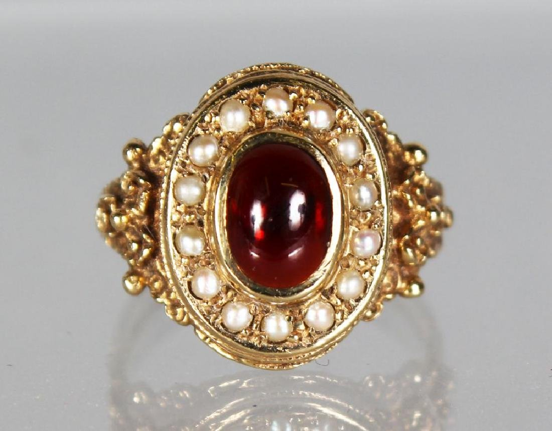 A GOLD DRESS RING with seed pearls and cabochon ruby.