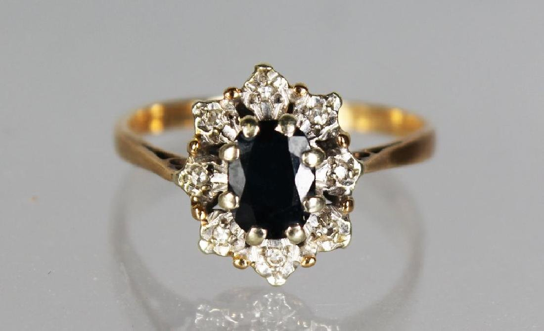 A GOLD CLUSTER DRESS RING.