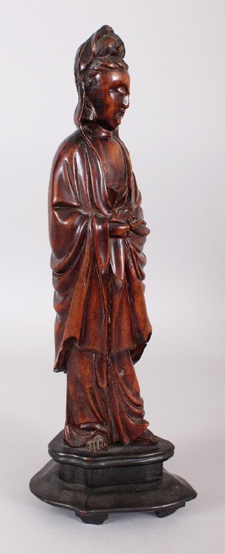 A 19TH CENTURY CHINESE CARVED WOOD FIGURE OF GUANYIN,