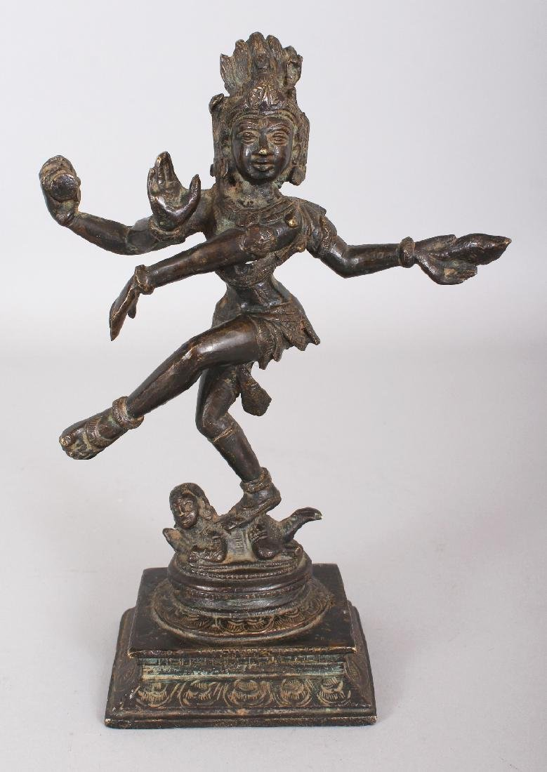 A 19TH CENTURY INDIAN BRONZE FIGURE OF SHIVA, dancing
