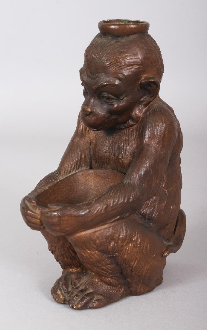 AN EARLY 20TH CENTURY JAPANESE BRONZED CERAMIC MODEL OF