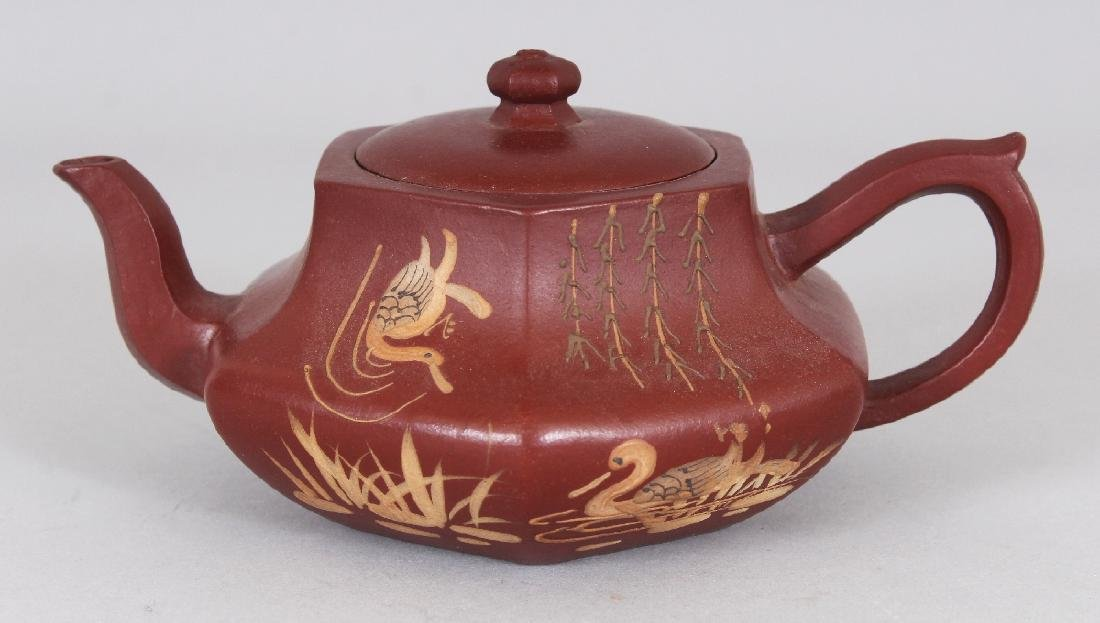 A CHINESE YIXING POTTERY SLIP DECORATED TEAPOT & COVER,