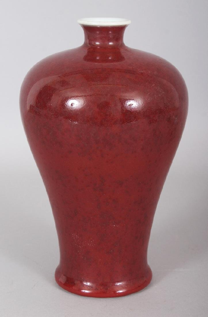 A CHINESE COPPER RED MEIPING PORCELAIN VASE, the base