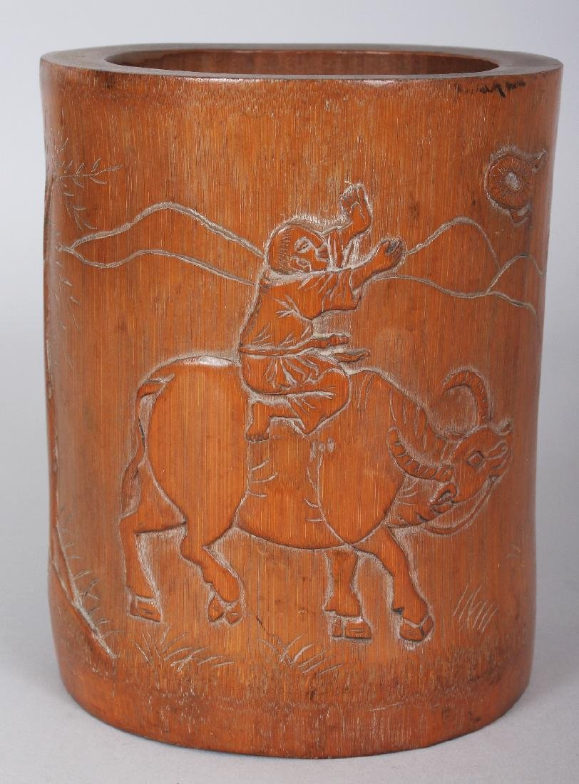 A SIGNED 19TH CENTURY CHINESE BAMBOO BRUSHPOT, carved