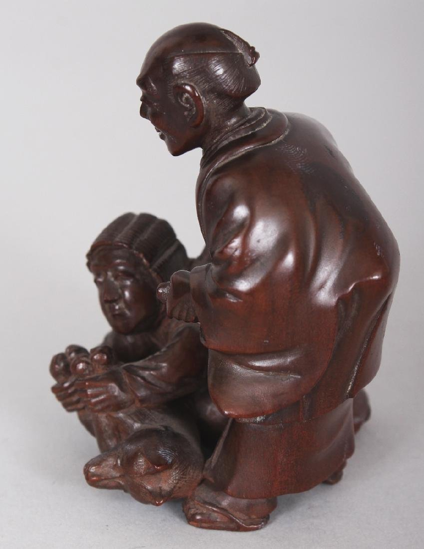 A JAPANESE CARVED WOOD GROUP OF TWO MEN & A FOX, one of - 2
