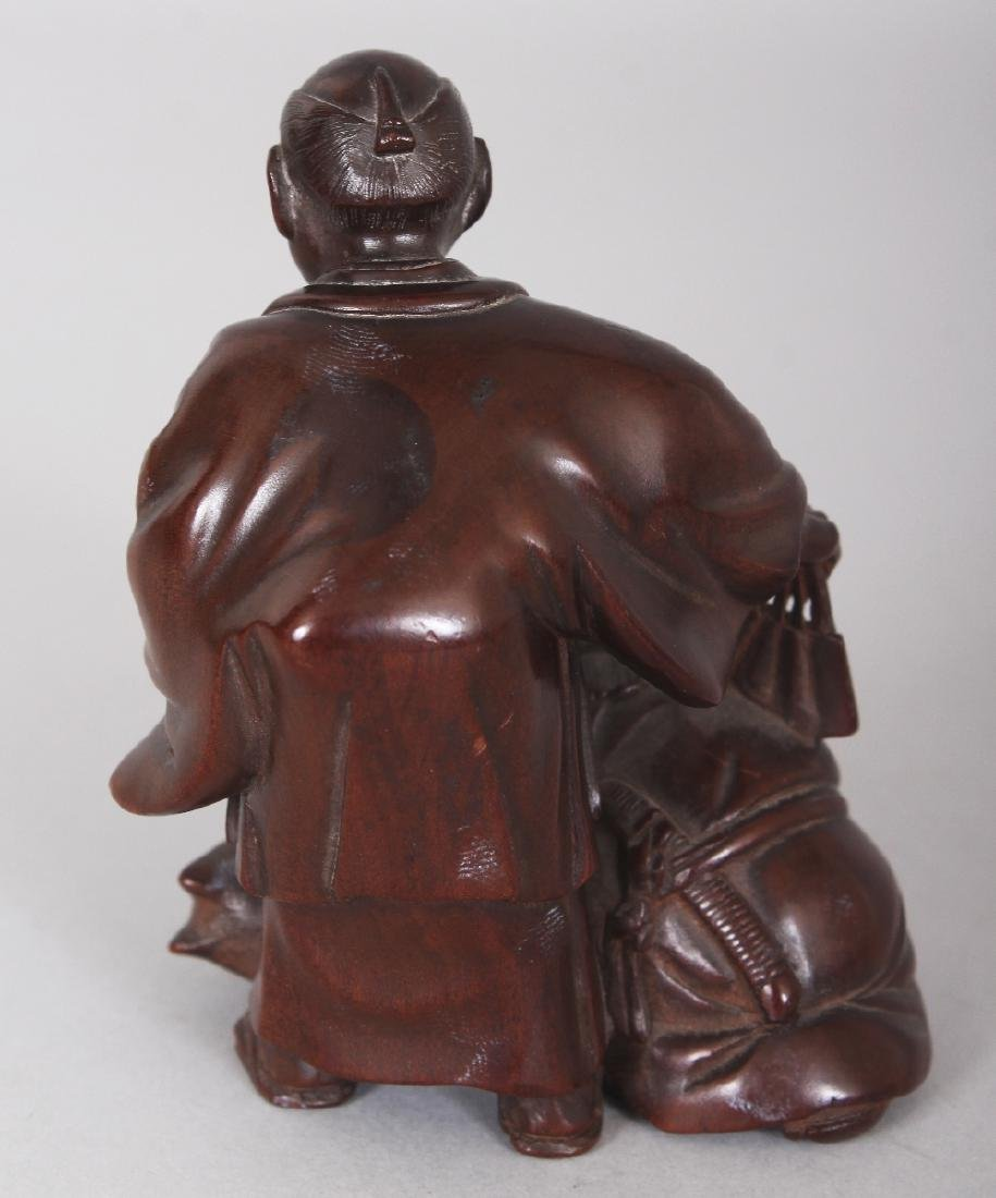 A JAPANESE CARVED WOOD GROUP OF TWO MEN & A FOX, one of - 3