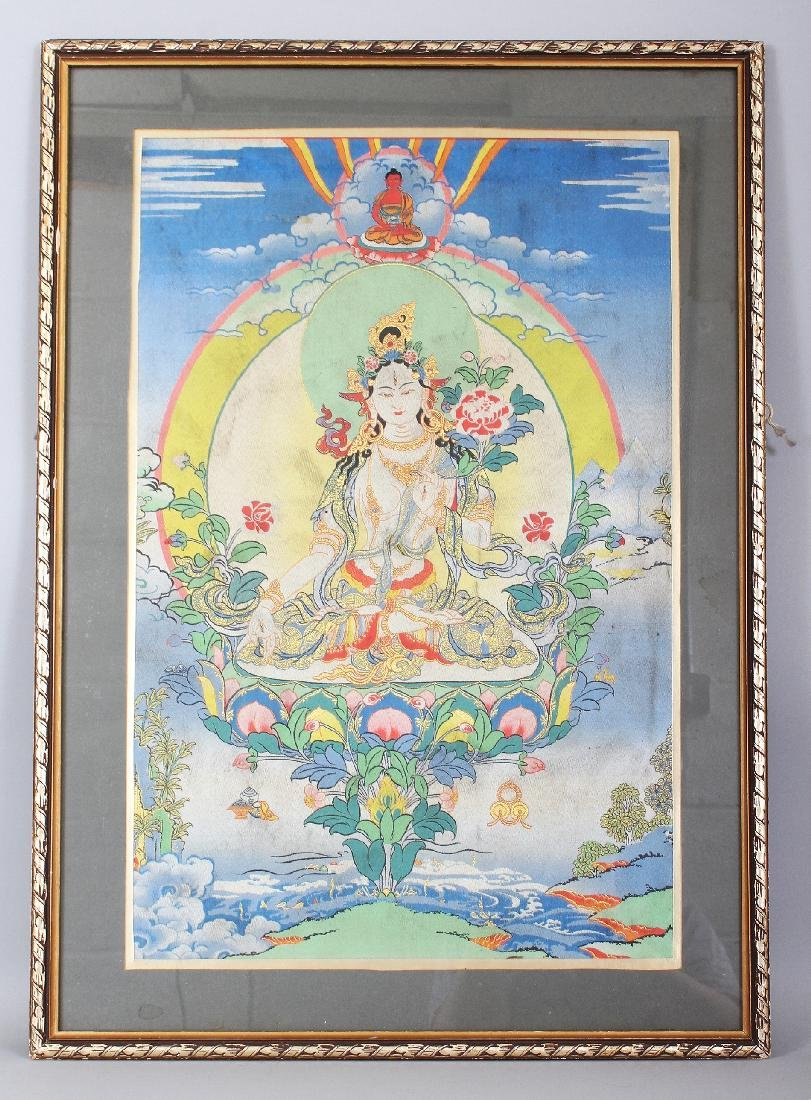 A FRAMED TIBETAN FABRIC THANGKA, the frame 29.1in x