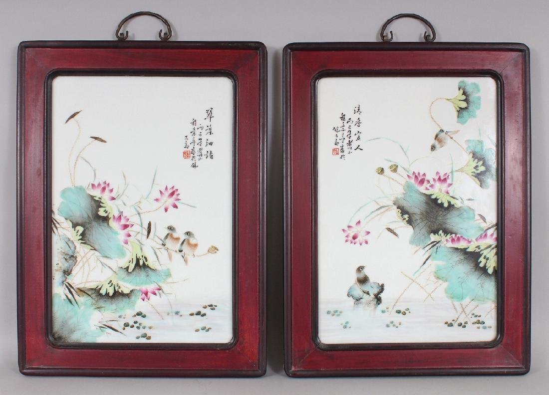 A PAIR OF CHINESE WOOD FRAMED FAMILLE ROSE PORCELAIN
