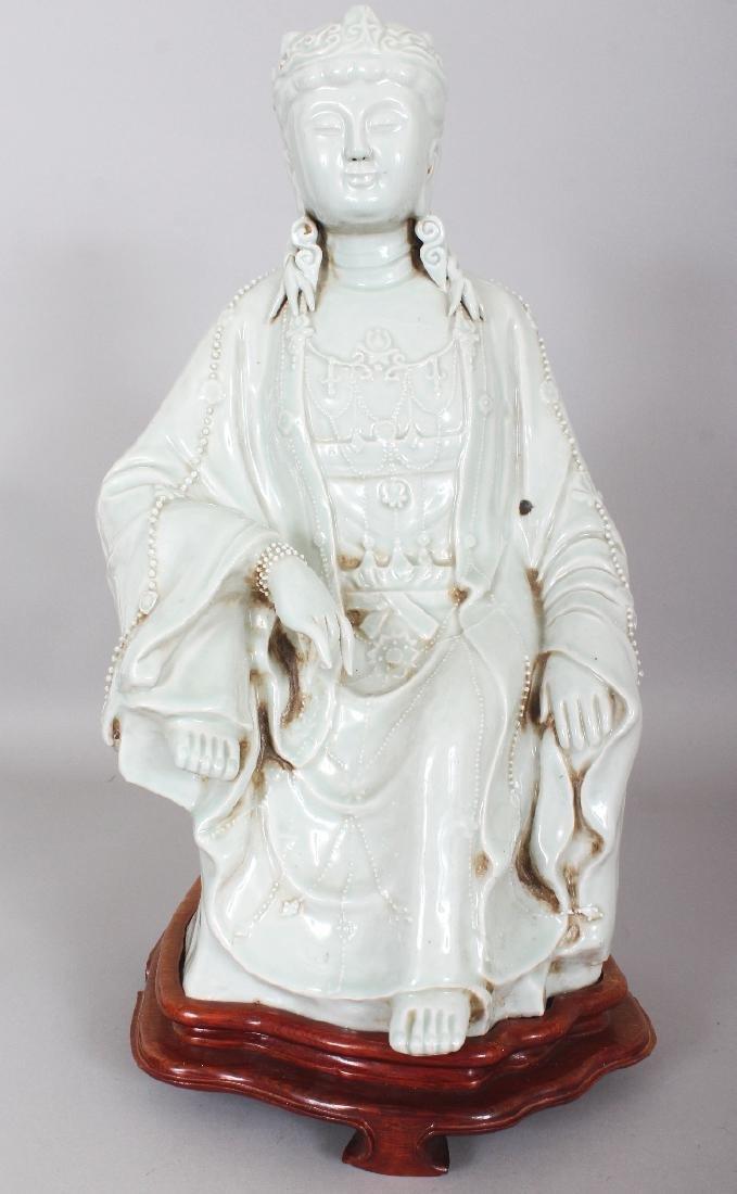 A LARGE CHINESE CELADON GLAZED PORCELAIN FIGURE OF