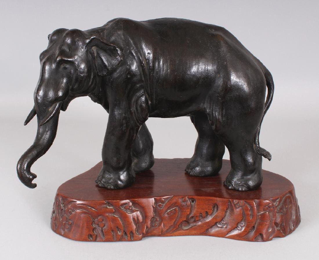 A SIGNED JAPANESE MEIJI PERIOD BRONZE MODEL OF A