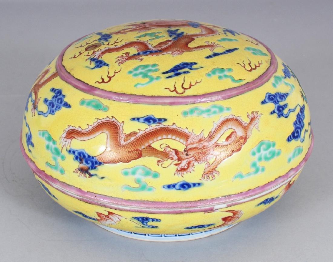 A CHINESE YELLOW GROUND CIRCULAR PORCELAIN DRAGON BOX &