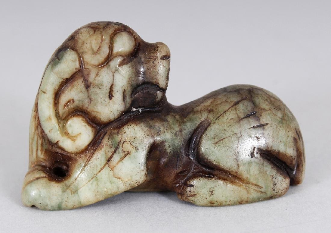 ANOTHER ARCHAIC STYLE JADE CARVING OF A RAM, 2.6in wide