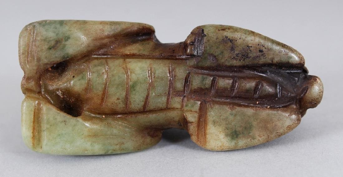 ANOTHER ARCHAIC STYLE JADE CARVING OF A RAM, 2.6in wide - 6