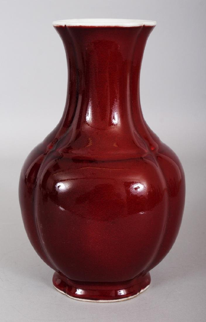 A CHINESE COPPER RED QUATREFOIL SECTION PORCELAIN VASE,