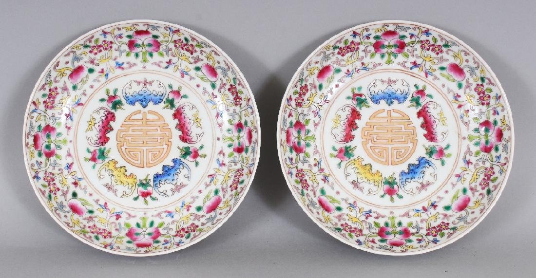 A PAIR OF CHINESE FAMILLE ROSE PORCELAIN SAUCERS, each