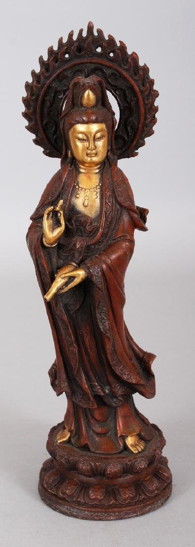 A CHINESE GILT BRONZE MODEL OF GUANYIN, standing on a