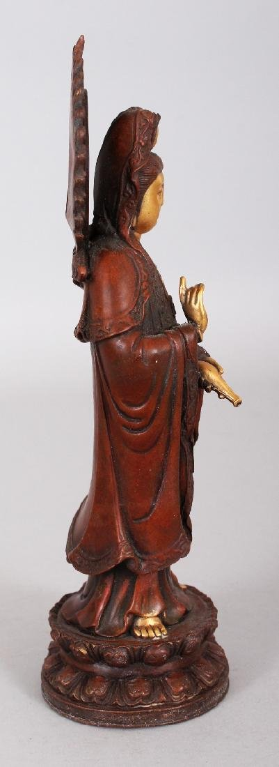 A CHINESE GILT BRONZE MODEL OF GUANYIN, standing on a - 2
