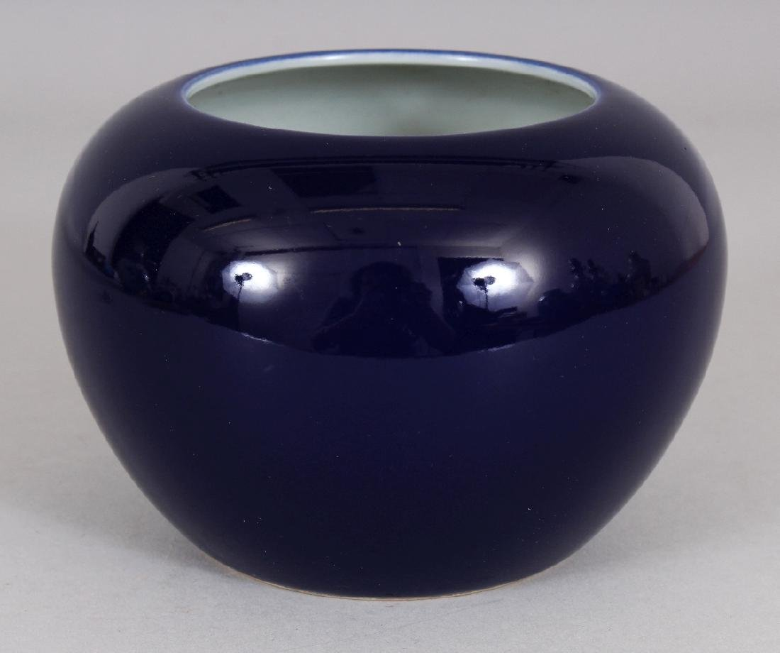 A CHINESE BLUE GLAZED PORCELAIN WATER POT, the base