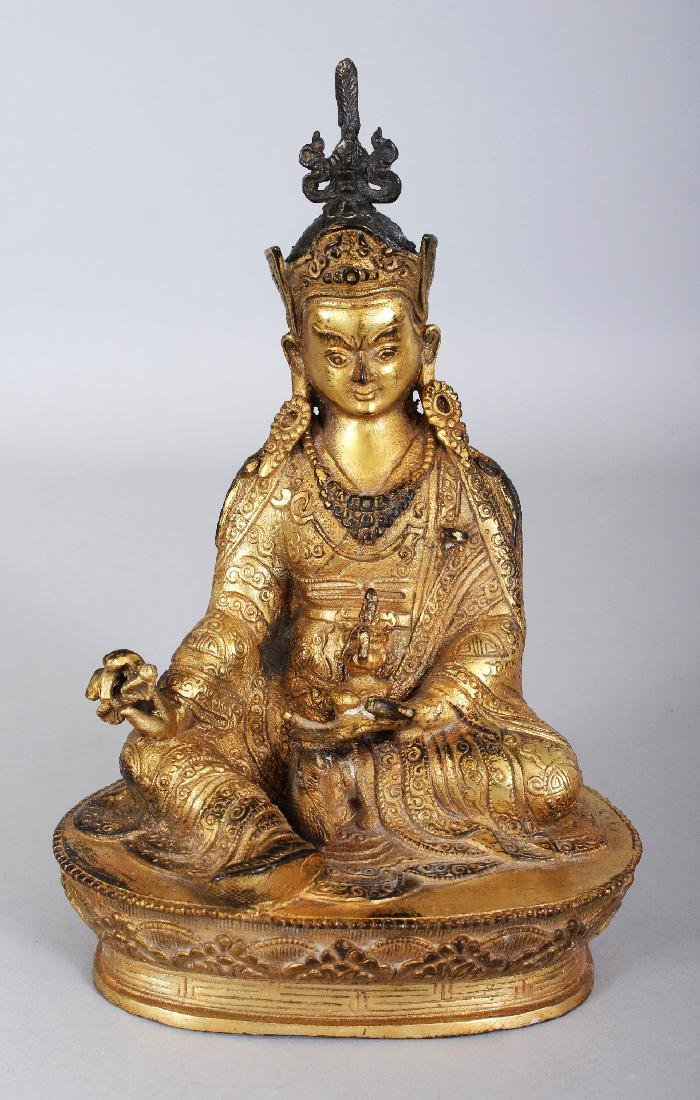 A SINO-TIBETAN GILT BRONZE FIGURE OF A KARMAPA, seated