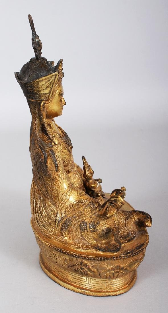 A SINO-TIBETAN GILT BRONZE FIGURE OF A KARMAPA, seated - 2