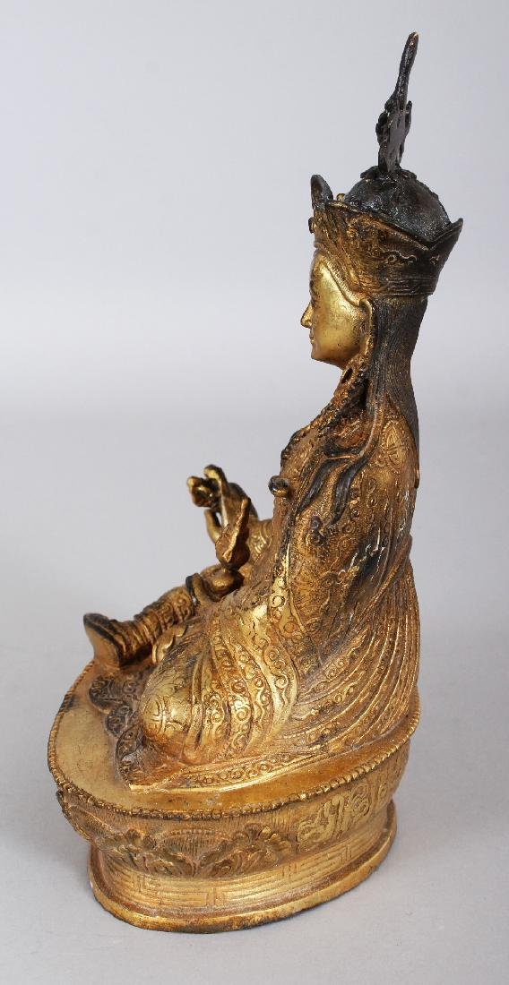 A SINO-TIBETAN GILT BRONZE FIGURE OF A KARMAPA, seated - 4