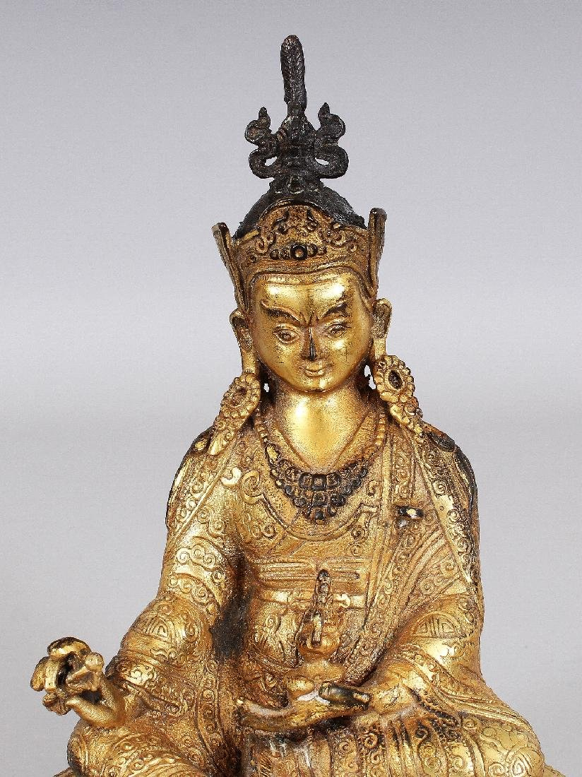 A SINO-TIBETAN GILT BRONZE FIGURE OF A KARMAPA, seated - 5