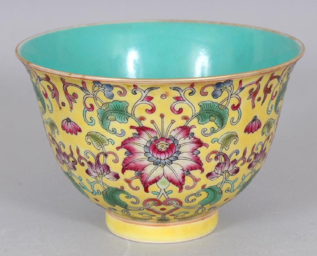 A CHINESE FAMILLE ROSE YELLOW GROUND PORCELAIN BOWL,