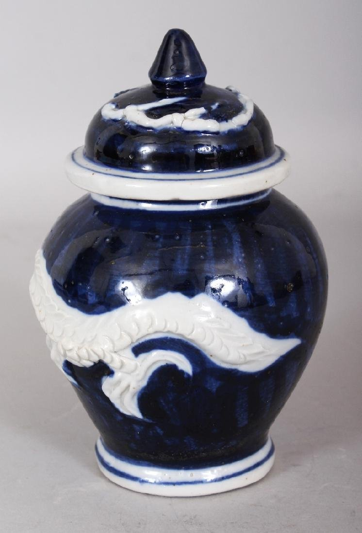 A CHINESE BLUE & WHITE MOULDED PORCELAIN DRAGON JAR & - 2