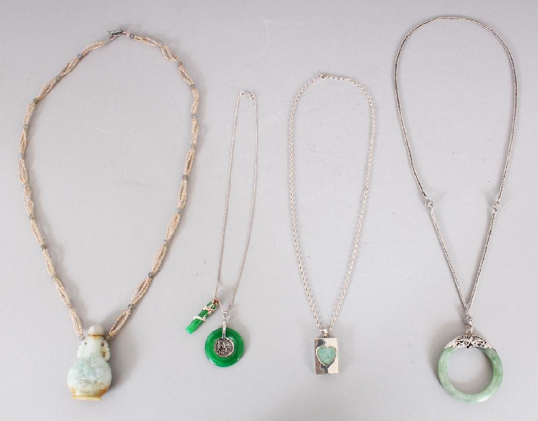 A GROUP OF FOUR CHINESE JADE ORNAMENT NECKLACES, with