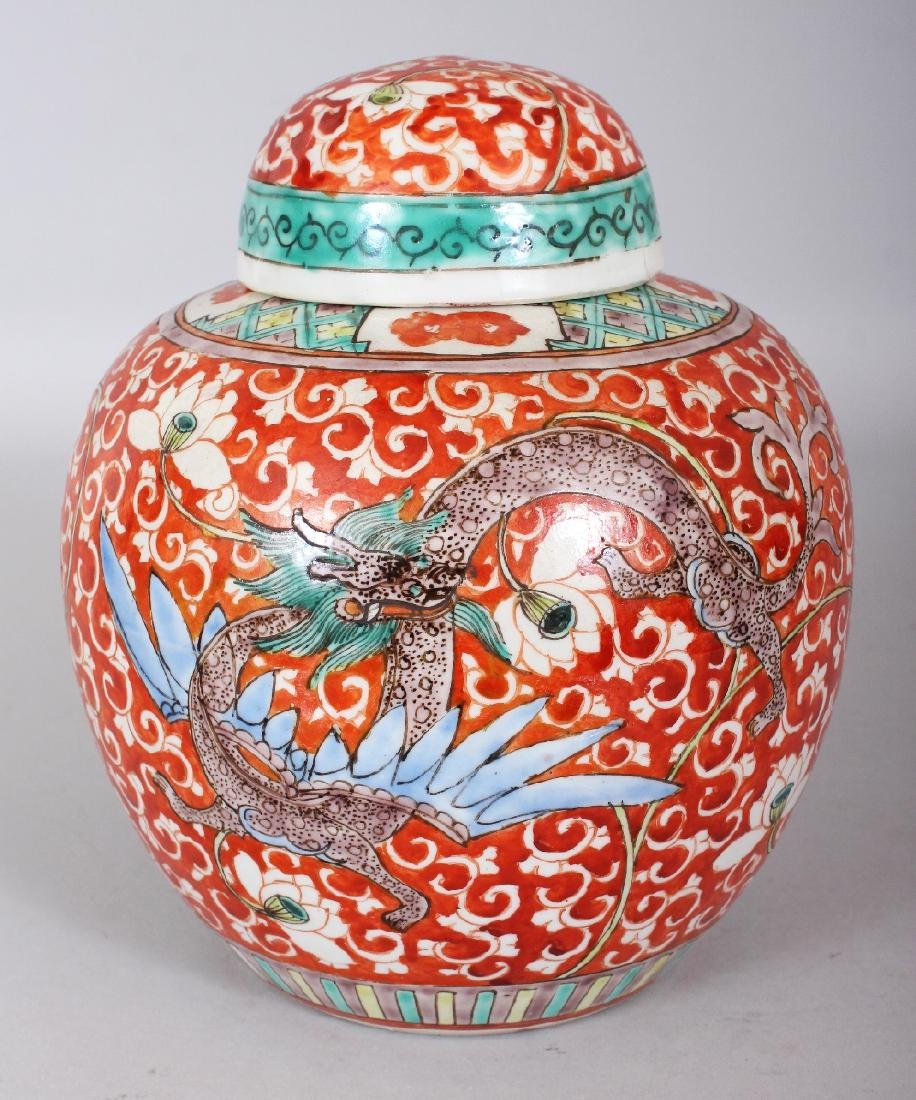 AN EARLY 20TH CENTURY CHINESE RED GROUND PORCELAIN