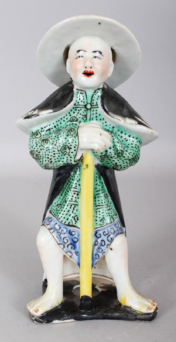 A 20TH CENTURY CHINESE ENAMELLED PORCELAIN FIGURE OF A