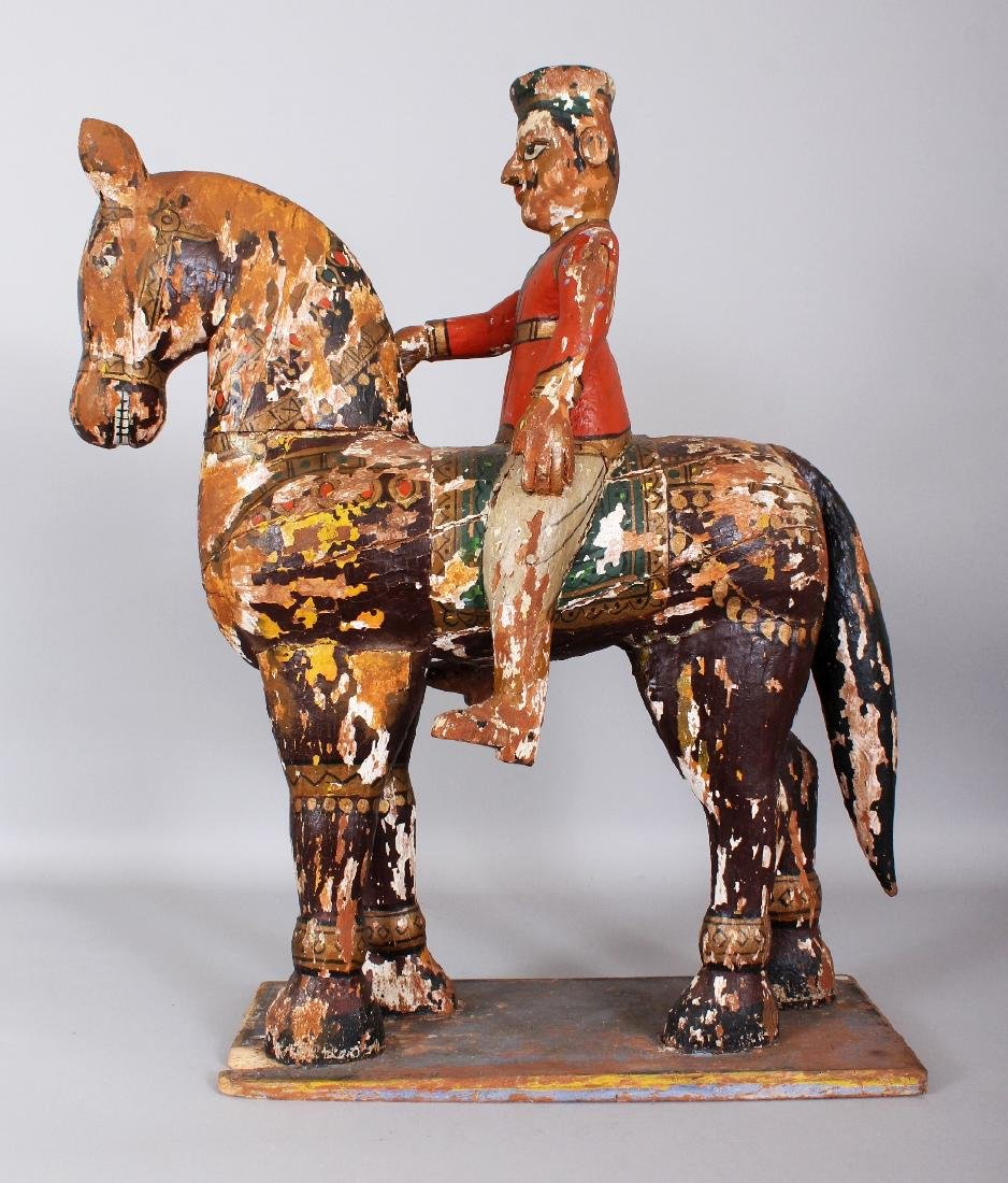 A LARGE 19TH CENTURY INDIAN LACQUERED WOOD FIGURE OF A