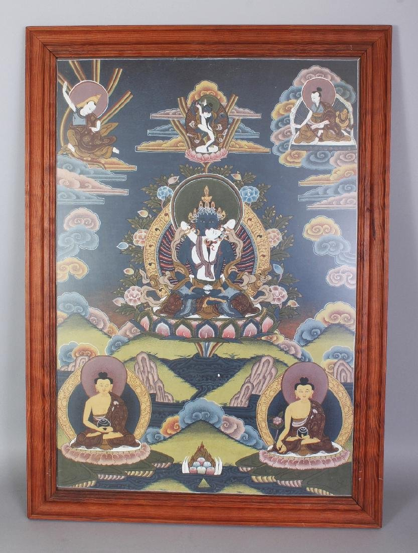 A FRAMED TIBETAN THANGKA, the frame 28.1in x 20.3in.